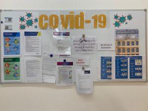 COVID board in JKWC Theatre